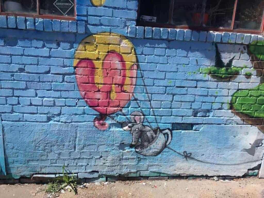 mouse in balloon denver street art