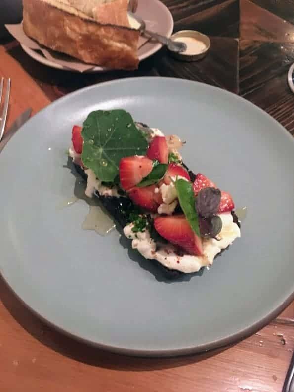 Ramp pumpernickel toast, feta strawberries honey and herbs dabney